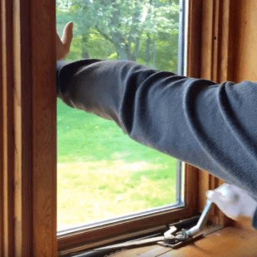 Image showing casement window being opened | OGS - Ontario Glazing Supplies